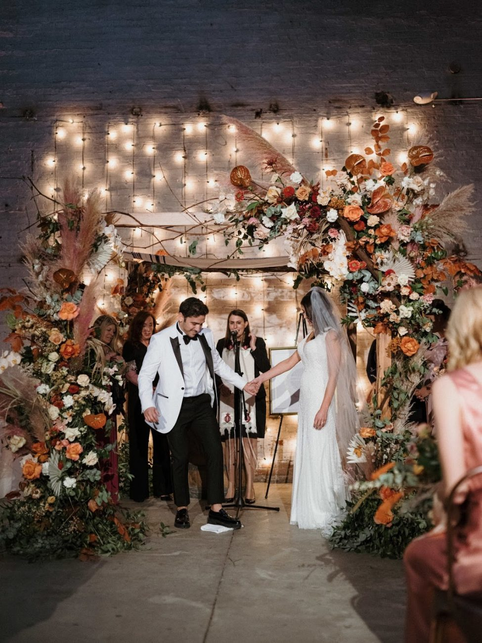 brooklyn industrial jewish wedding chuppah flowers