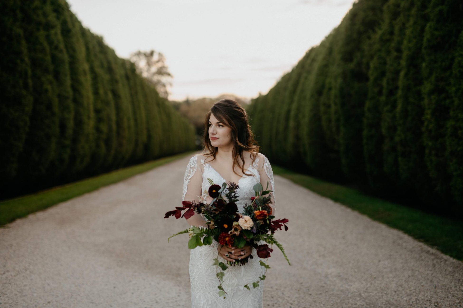 Long Island Wedding Bride Holding Wedding Bouquet of Florals